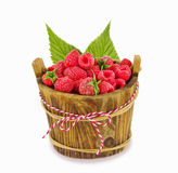 Raspberries in wooden bowl isolated on white. Ripe and tasty berry with leaves Royalty Free Stock Photos