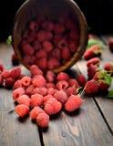 Raspberries in a wooden bowl. Juicy, ripe, mature raspberries in a wooden bowl Stock Photos