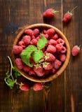 Raspberries in a wooden bowl. Juicy, ripe, mature raspberries in a wooden bowl Stock Images