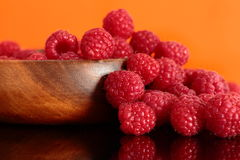 Raspberries in a wooden bowl. Reflected Royalty Free Stock Photography
