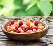 Raspberries in the wooden bowl. Raspberries in the wooden bowl on the table Royalty Free Stock Photo