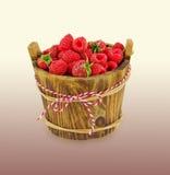 Raspberries in wooden bowl. Vegetarian or healthy eating. Juicy and delicious raspberries Stock Photos