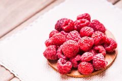 Raspberries on a wooden cutting board. Fresh raspberries on a wooden cutting board,forrest garden berries, sweet and healthy eating Royalty Free Stock Photo