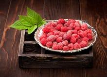 Raspberries. On a wooden dark background Stock Image
