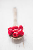 Raspberries in wooden spoon on white background Royalty Free Stock Photography