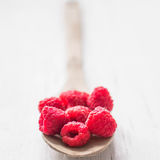 Raspberries in wooden spoon on white background Royalty Free Stock Images