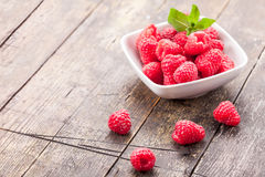 Raspberries on wooden table Royalty Free Stock Photo