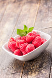 Raspberries on wooden table Stock Photography