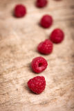 Raspberries on a wooden table Stock Images