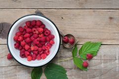 Raspberries on wooden table. Food background. Overhead view. Copy space Royalty Free Stock Images