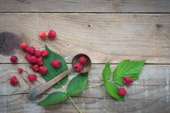 Raspberries on wooden table. Food background. Overhead view. Copy space Stock Photography
