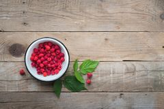 Raspberries on wooden table. Food background. Overhead view. Copy space Stock Images