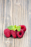 Raspberries on a wooden table Stock Photos