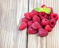 Raspberries on a wooden table Stock Image