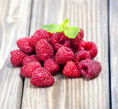 Raspberries on a wooden table Royalty Free Stock Photo
