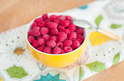 Raspberries on wooden table. Healthy food. Bowl with raspberries on wooden table. Healthy food Stock Photos