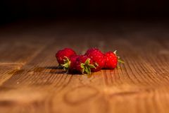 Raspberries on a wooden table. royalty free stock images