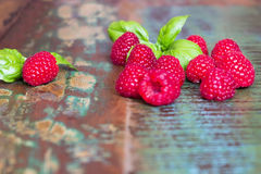 Raspberries on a wooden table Stock Photo