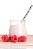 Raspberries yogurt with a spoon Royalty Free Stock Images