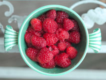 Raspberry in ancient cup Stock Photo