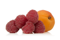 Raspberry and apricot. Fresh raspberries and apricot isolated over white background Royalty Free Stock Photography