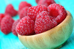 Raspberry in a bamboo bowl on table. Raspberry in a bamboo bowl on wooden table Royalty Free Stock Image