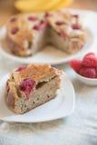 Raspberry Banana Cake. On a table Royalty Free Stock Photography