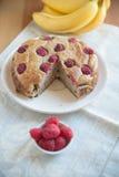 Raspberry Banana Cake. On a table Stock Photography