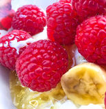 Raspberry, Banana and Honey. Berries and banana with honey on the plate Royalty Free Stock Images