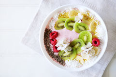Raspberry and banana smoothie bowl with kiwi slices, shredded co. Conut and chia seeds. Healthy food concept Royalty Free Stock Photos