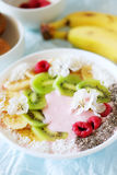 Raspberry and banana smoothie bowl with kiwi slices, shredded co. Conut and chia seeds. Healthy food concept Stock Photos