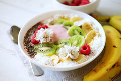 Raspberry and banana smoothie bowl with kiwi slices, shredded co. Conut and chia seeds. Healthy food concept Royalty Free Stock Photo