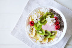 Raspberry and banana smoothie bowl with kiwi slices, shredded co. Conut and chia seeds. Healthy food concept Royalty Free Stock Images