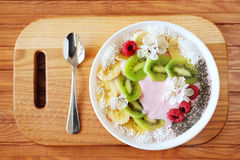Raspberry and banana smoothie bowl with kiwi slices, shredded co. Conut and chia seeds. Healthy food concept Stock Images