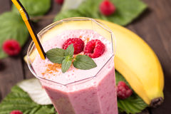 Raspberry banana smoothie closeup. Raspberry banana smoothie with mint closeup shot Stock Images