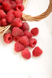Raspberry in a basket on the table Royalty Free Stock Images