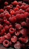 Raspberry berries on a black background stock photos