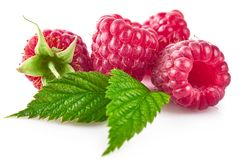 Raspberry berries with green leaf healthy food Stock Photos