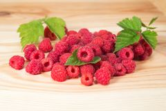 Raspberry berries on wooden background Stock Photo