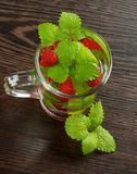Raspberry Beverage. With Perfect Fresh Lemon-Balm Leafs in Glass Cup on Dark Wooden background. Top View Royalty Free Stock Images