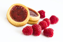Raspberry biscuits with a few beries. On white background Royalty Free Stock Photography