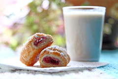 Raspberry bites pastries with a glass of almond milk Royalty Free Stock Photos
