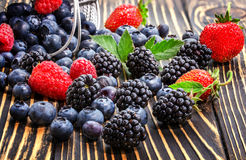 Raspberry, blackberry and blueberry  on a wooden table. Royalty Free Stock Photos