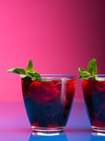 Raspberry and blackberry cocktail with mint garnish. Stock Photography