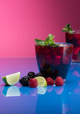 Raspberry and blackberry cocktail with mint garnish. Studio shot Stock Image