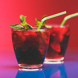 Raspberry and blackberry cocktail with mint garnish. Studio shot Stock Photos