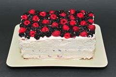 Raspberry and blackberry homemade cake. Homemade fresh berries cake on a plate Stock Image