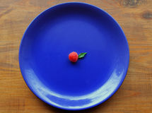 Raspberry on the blue plate stock image