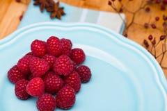 Raspberry on blue plate Royalty Free Stock Photos