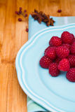 Raspberry on blue plate Stock Photography